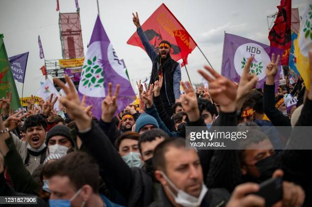 Supporters of pro-Kurdish Peoples' Democratic Party cheer during a gathering to celebrate Nowruz, the Persian New Year, in Istanbul on March 20, 2021.