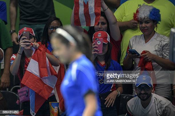 Supporters of Puerto Rico's Adriana Diaz cheer at the Riocentro venue during the Rio 2016 Olympic Games in Rio de Janeiro on August 6 2016 / AFP /...