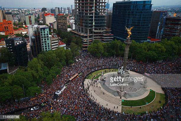 Supporters of Pumas celebrate the title of Clausura Tournament 2011 after a victory over Morelia at Angel de la Independencia on May 22 2011 in...