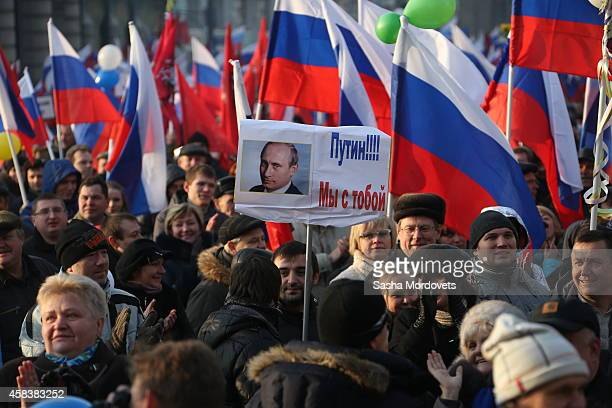 Supporters of Putin and Kremlin march as thousands gather in Central Moscow for a traditional Sovietstyle rally honouring the National Unity Day on...