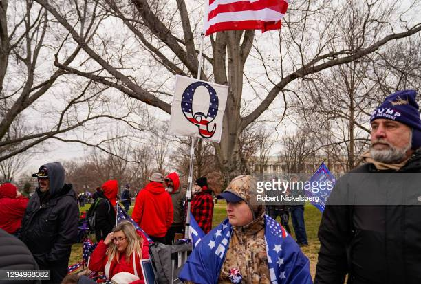 """Supporters of Q-Anon and crowds gather outside the U.S. Capitol for the """"Stop the Steal"""" rally on January 06, 2021 in Washington, DC. Trump..."""