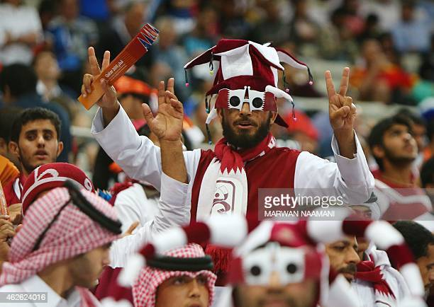 Supporters of Qatar cheer during the 24th Men's Handball World Championships final match between Qatar and France at the Lusail Multipurpose Hall in...