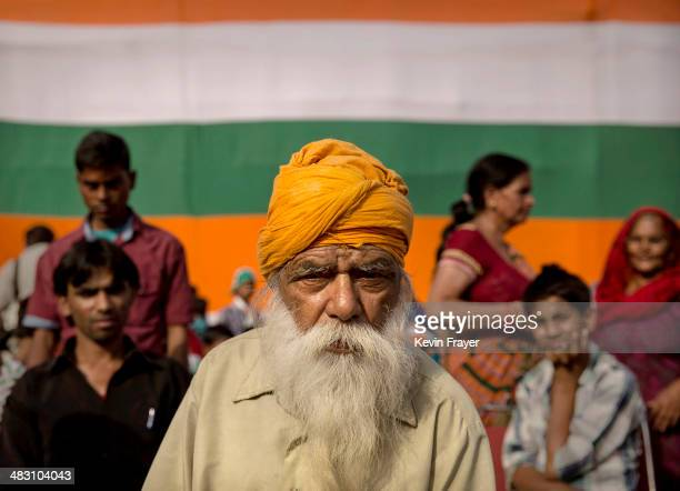 Supporters of Rahul Gandhi the leader of India's ruling Congress Party gather at a rally on April 6 2014 in New Delhi India India will vote in a nine...