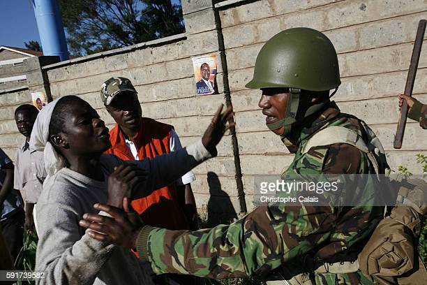 Supporters of Ralia Odinga are blocked by police on Ngong Road as they try to reach Uhuru Park in central Nairobi to attend their party's political...