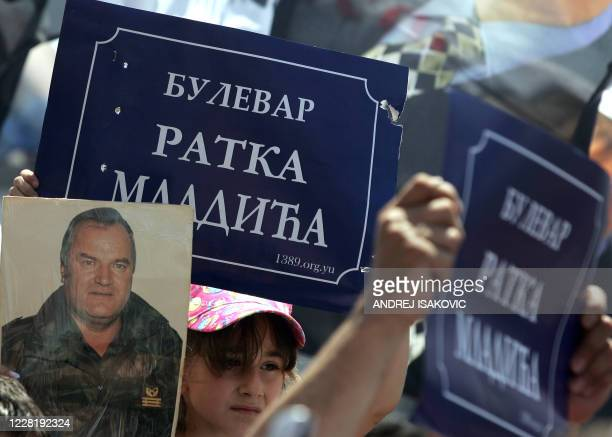 """Supporters of Ratko Mladic hold posters bearing the name """"Ratko Mladic Boulevard"""" in Belgrade, 26 May 2007. A few hundred ultranationalists, among..."""