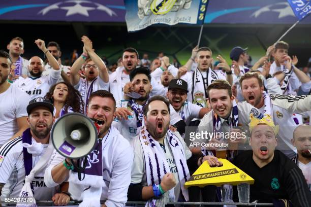 Supporters of Real Madrid cheer prior to the UEFA Champions League Group H football match BVB Borussia Dortmund v Real Madrid in Dortmund, western...