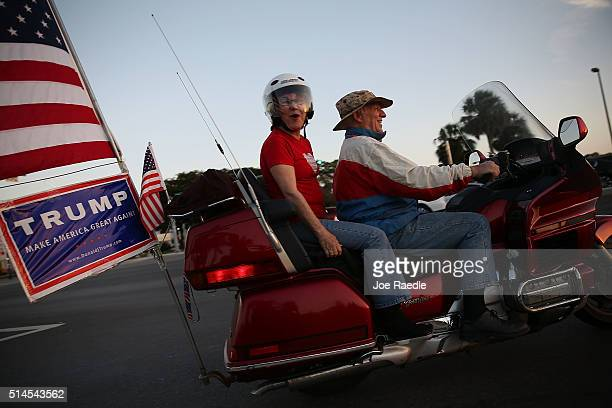 Supporters of Repubican presidential candidate Donald Trump drive their motorcycle near where Democratic presidential candidate Senator Bernie...