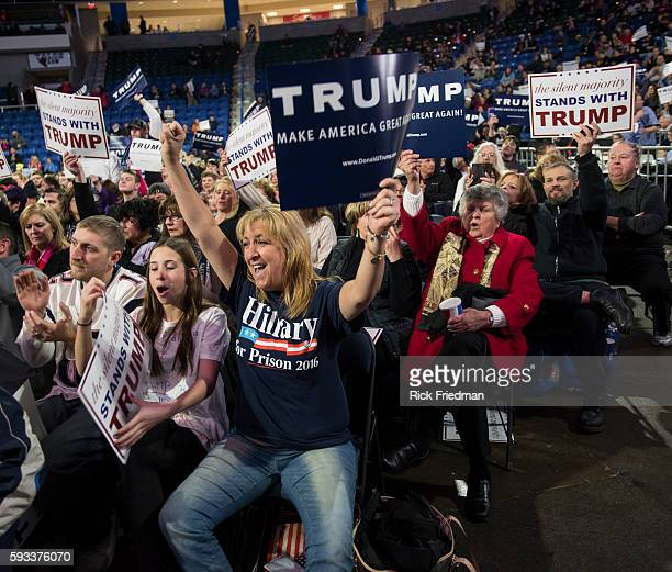 Supporters of Republican presidential candidate Donald Trump including a woman wearing a Hillary for Prison 2016 during a campaign rally at the...