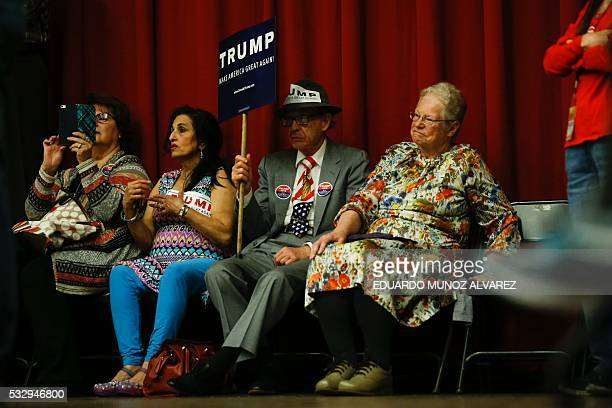 TOPSHOT Supporters of Republican presidential candidate Donald Trump attend a fundraising event in Lawrenceville New Jersey on May 19 2016 / AFP /...