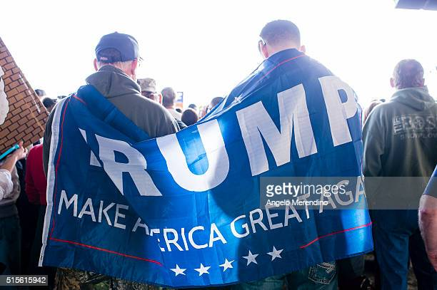 Supporters of Republican presidential candidate Donald Trump gather at Youngstown Airport on March 14 2016 in Vienna Ohio Polls show Trump and Ohio...