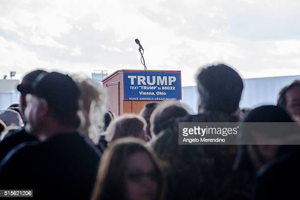 Supporters of Republican presidential candidate Donald Trump gather before the Trump's arrival at Youngstown Airport on March 14 2016 in Vienna Ohio...