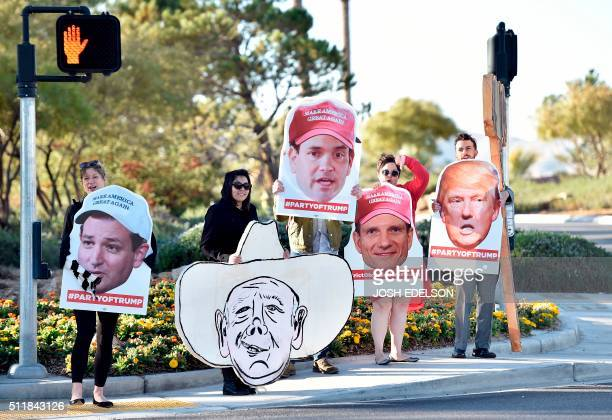 Supporters of Republican presidential candidate Donald Trump hold out signs at the entrance to Silverton Casino where candidate Marco Rubio held a...