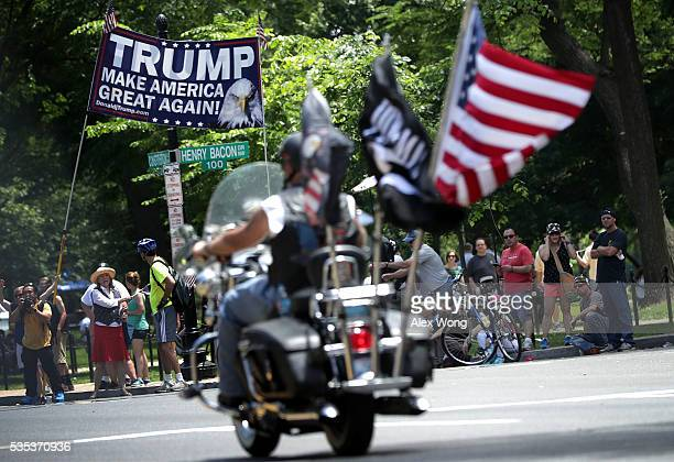 Supporters of Republican presidential candidate Donald Trump hold up a banner during the annual Rolling Thunder First Amendment Demonstration Run May...