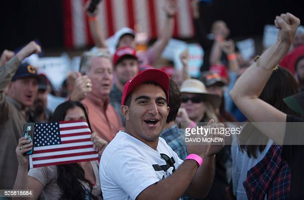 Supporters of Republican presidential candidate Donald Trump jeer at members of the press during his campaign rally at the Orange County Fair and...