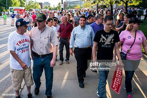 Supporters of Republican Presidential candidate Donald Trump leave a political rally at the James A Rhodes Arena on August 22 2016 in Akron Ohio...