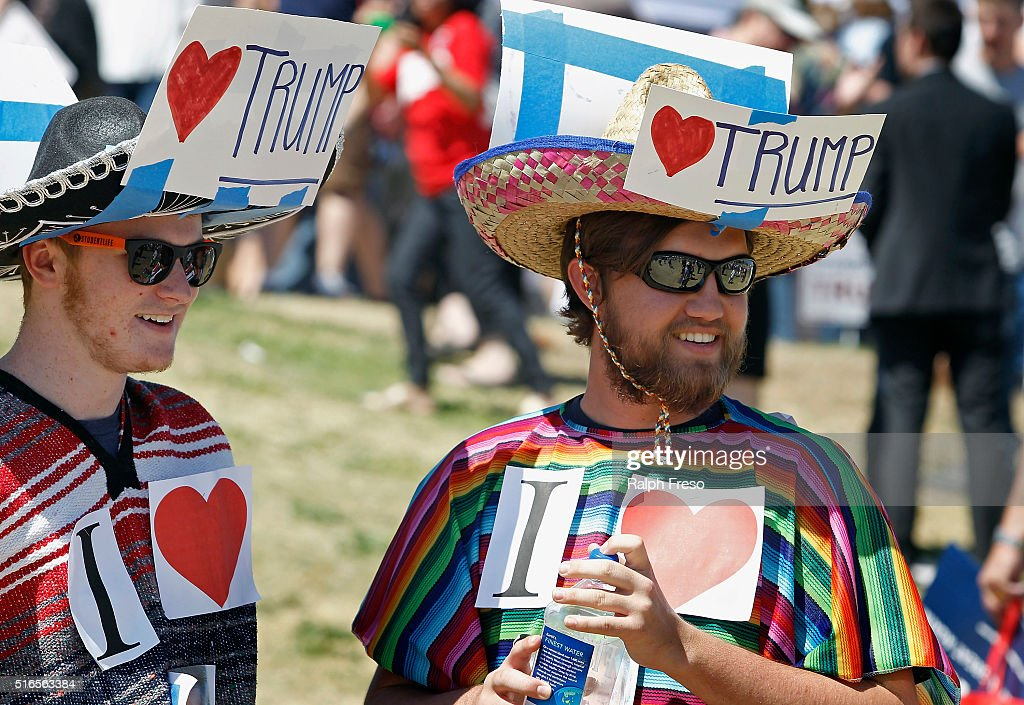 Supporters of Republican presidential candidate Donald Trump look on during Fountain Park during a campaign rally on March 19, 2016 in Fountain Hills, Arizona. Trumps visit to Arizona is the second time in three months as he looks to gain the GOP nomination for President.