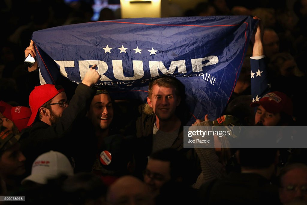 Supporters of Republican presidential candidate Donald Trump wait for results to come in on Primary day at his election night watch party at the Executive Court Banquet facility on February 9, 2016 in Manchester, New Hampshire. Trump was projected the Republican winner shortly after the polls closed.