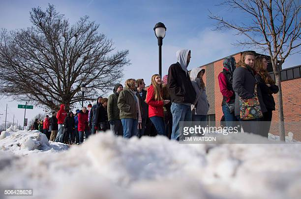 Supporters of Republican Presidential Candidate Donald Trump wait in line to see if they will be let in prior to a campaign rally in Pella Iowa...