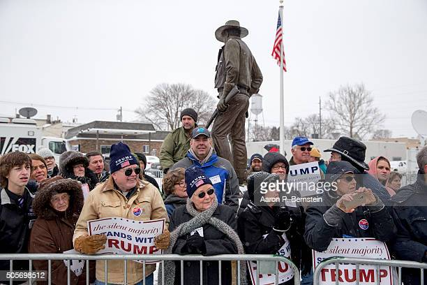 Supporters of Republican presidential candidate Donald Trump wait outside the John Wayne Birthplace Museum on January 19 2016 in Winterset Iowa Trump...