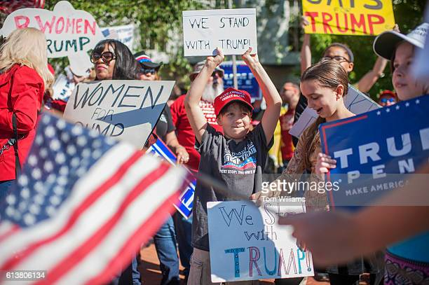 Supporters of Republican presidential candidate DonaldTrump rally outside of the Republican National Committee headquarters on Capitol Hill October...