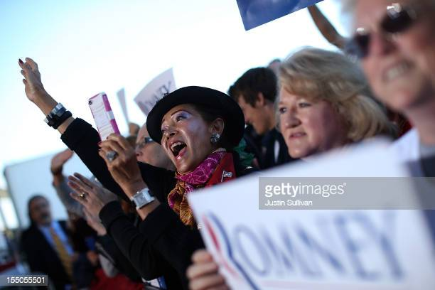 Supporters of Republican presidential candidate former Massachusetts Gov Mitt Romney cheer during campaign rally at Tampa International Airport on...