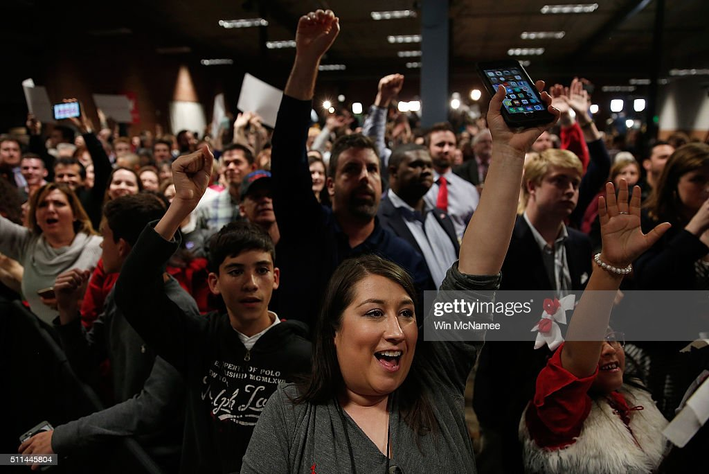 Supporters of Republican presidential candidate Marco Rubio greets celebrate as early returns are shown on television at a primary night event February 20, 2016 in Columbia, South Carolina. The Republican field of candidates faced of today in the 'First in the South' primary.