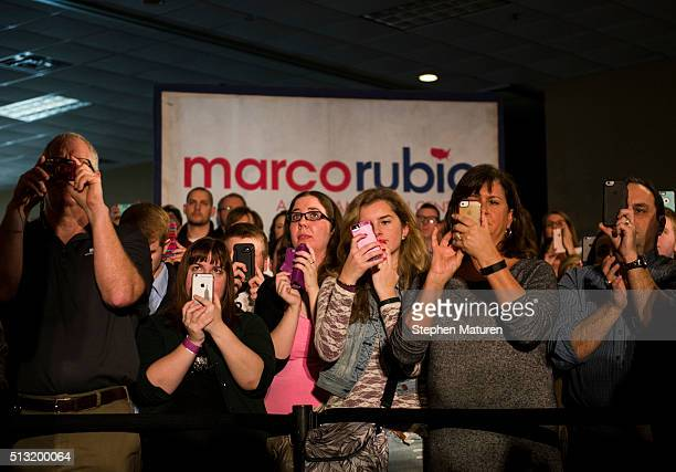 Supporters of Republican presidential candidate Sen Marco Rubio photograph him as he speaks during a campaign rally at Courtyards of Andover Event...