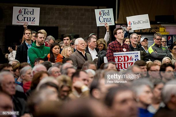 Supporters of Republican presidential candidate Sen Ted Cruz listen as a campaign surrogate addresses voters at a caucus site as Iowans prepare to...