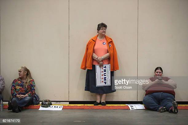 Supporters of Republican presidential nominee Donald Trump and his running mate Indiana Governor Mike Pence wait for the start of a campaign rally on...