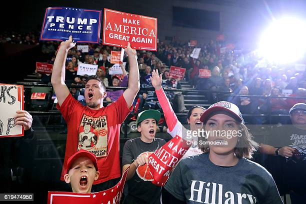 Supporters of Republican presidential nominee Donald Trump cheer during a campaign rally at the Deltaplex Arena October 31 2016 in Grand Rapids...