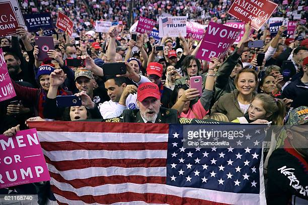 Supporters of Republican presidential nominee Donald Trump cheer for him during a campaign rally at the Giant Center November 4 2016 in Hershey...