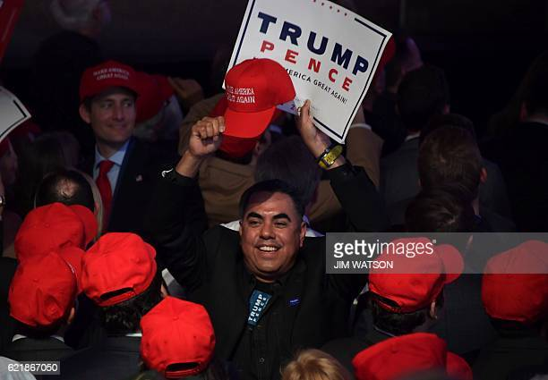 Supporters of Republican presidential nominee Donald Trump cheer during election night at the New York Hilton Midtown in New York on November 8 2016...
