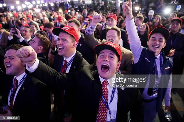 Supporters of Republican presidential nominee Donald Trump cheer during the election night event at the New York Hilton Midtown on November 8 2016 in...