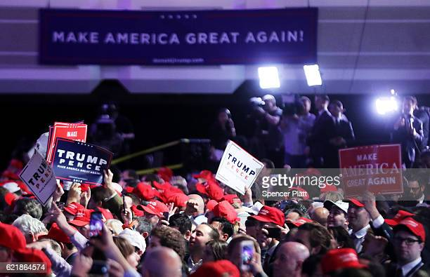 Supporters of Republican presidential nominee Donald Trump gather during the election night event at the New York Hilton Midtown on November 8 2016...