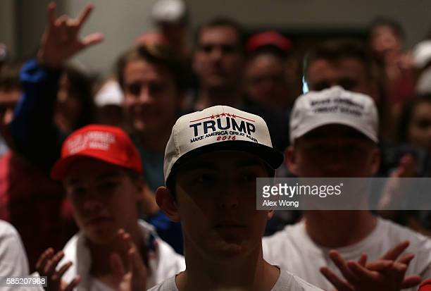 Supporters of Republican presidential nominee Donald Trump listen to his stump speech during a campaign event at Briar Woods High School August 2,...