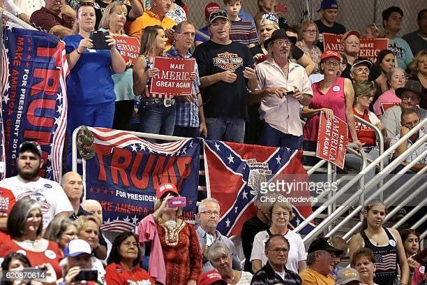 Supporters of Republican presidential nominee Donald Trump listen to him during a campaign rally at the Jacksonville Equestrian Center November 3...