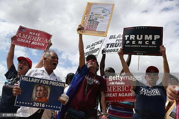 Supporters of Republican presidential nominee Donald Trump show their support for him before the start of the campaign event for Democratic...