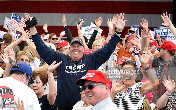 Supporters of Republican presidential nominee Donald Trump turn toward members of the media during a campaign rally at the Henderson Pavilion on...