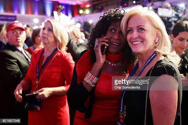 Supporters of Republican presidential nominee Donald Trump watch early results during the election night event at the New York Hilton Midtown on...
