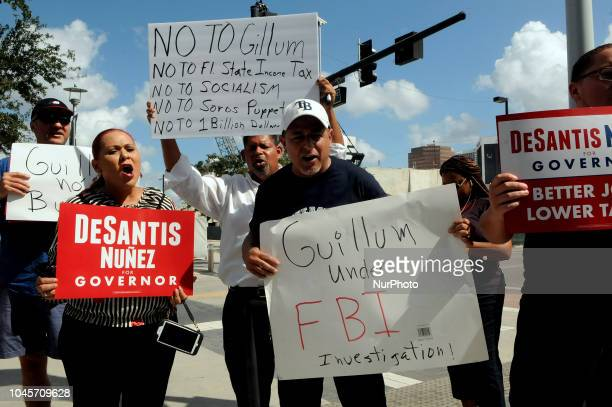 Supporters of Republican Ron DeSantis protest as Democratic gubernatorial nominee Andrew Gillum holds a campaign event on October 4 2018 beside...