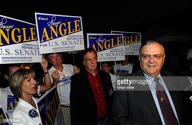 Supporters of Republican Senate candidate Sharron Angle stand behind Maricopa County Arizona Sheriff Joe Arpaio as he is interviewed before speaking...
