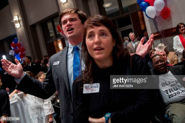 Supporters of Republican senatorial candidate Roy Moore sing gospel after election results show Moore lost in Montgomery Alabama on December 12 2017...