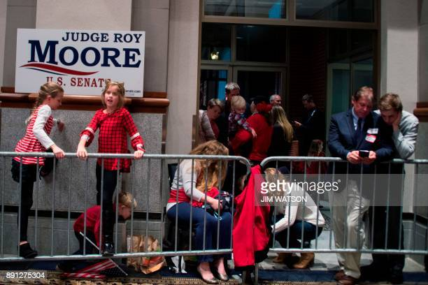 Supporters of Republican senatorial candidate Roy Moore wait for results at an election night party in Montgomery Alabama on December 12 2017...