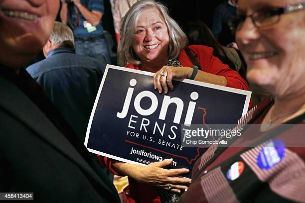 Supporters of Republican U.S. Senate candidate Joni Ernst gather for an election night party at the Marriott Hotel November 4, 2014 in West Des...
