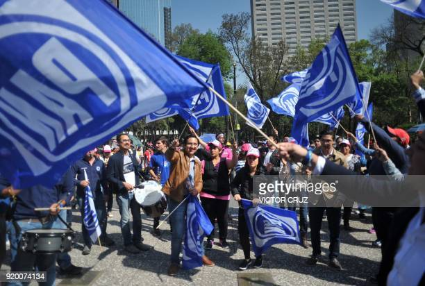 Supporters of Ricardo Anaya wave National Action Party flags as they arrive for the official announcement of his presidential candidacy for the...