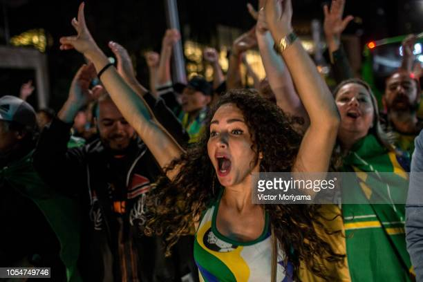 Supporters of right-wing candidate Jair Bolsonaro of PSL party celebrate victory in the presidential elections on October 28, 2018 in Sao Paulo,...