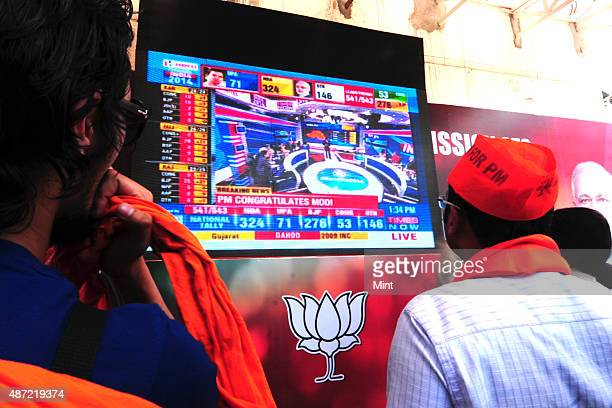 Supporters of rightwing nationalist Bharatiya Janata Party celebrating after the victory of the party in General Elections 2014 outside the BJP...
