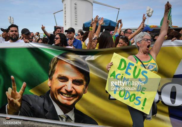 Supporters of rightwing presidential candidate Jair Bolsonaro gather at Copacabana beach during the Women for Bolsonaro demonstration in Rio de...