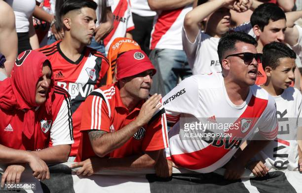 Supporters of River Plate cheer at the Monumental stadium in Buenos Aires on November 24 2018 while authorities decide if the second leg match of the...