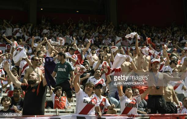 Supporters of River Plate cheer before the start of the second leg match of the allArgentine Copa Libertadores final against Boca Juniors at the...
